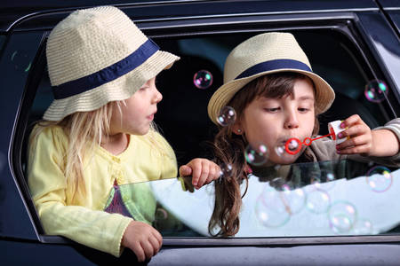 Two young friends in the car
