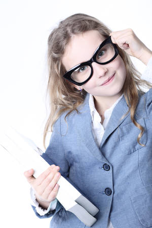 Smiling schoolgirl with books on a white background