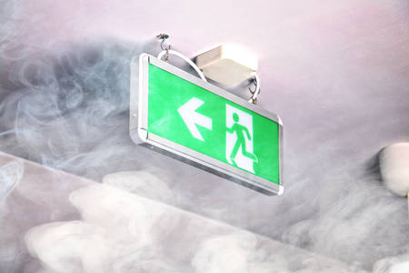 Smoke in the building and escape route Stock Photo