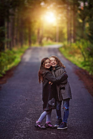 Young girls hugs in a sunny autumn day Stok Fotoğraf