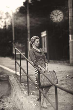 Pensive woman on railway station