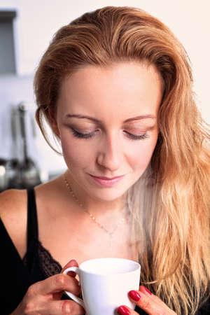 cheerful woman is drinking coffee Stock Photo