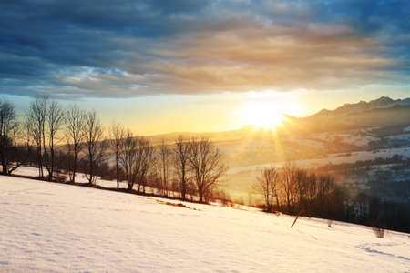 Beautiful and colorful view of the rising sun in winter