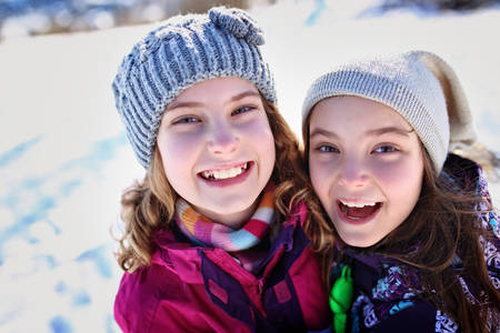 happy and smiling young girls in a winter day Stock Photo