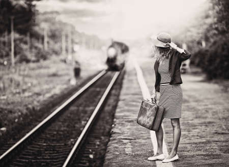 woman is waiting for a steam train