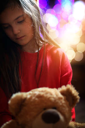 sad and lonley young girl at christmas