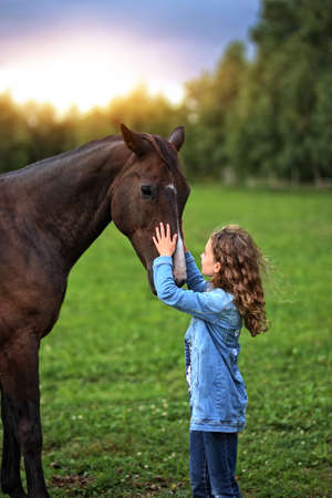 girl on ranch with horse
