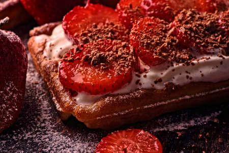 delicious crispy waffles with chocolate sprinkles and strawberries