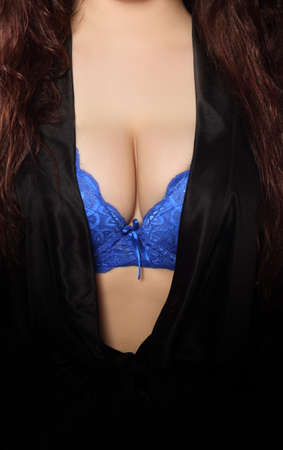 sensual dress and breasts in a bra