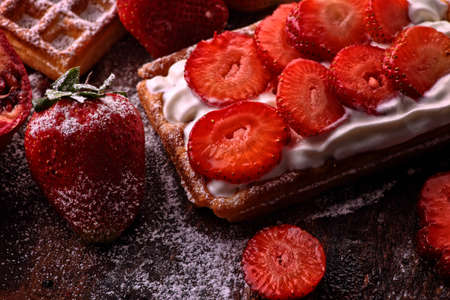 crispy waffles with whipped cream and strawberries