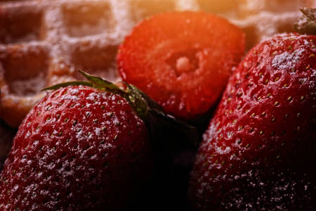 crispy waffles with strawberries and powdered sugar