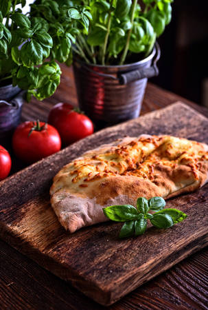 homemade calzone on a wooden board
