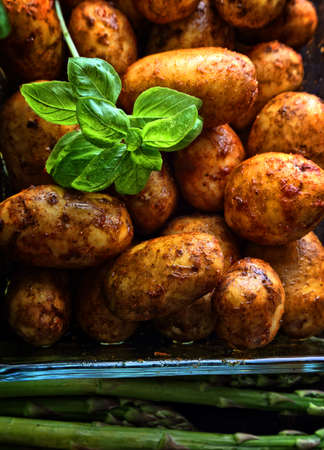 baked potatoes with spices Фото со стока