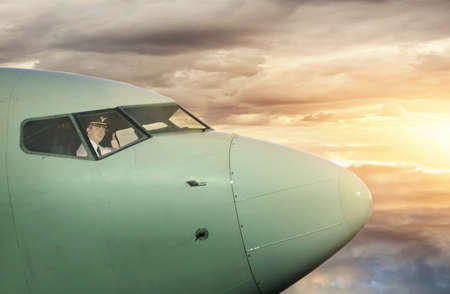 Captain looking out the window in the plane