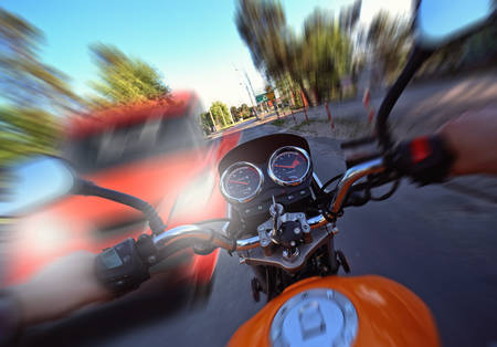 accident and frontal collision of a car with a motorcycle Stok Fotoğraf