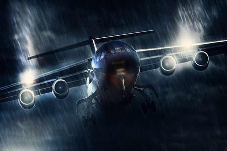 plane landing in a heavy rain shower