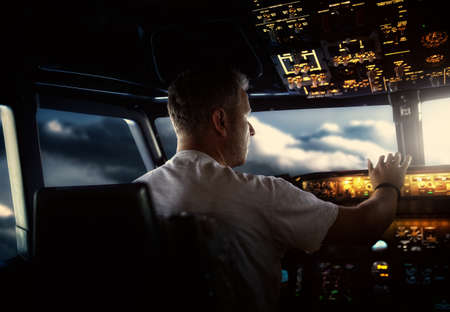 pilot switches the buttons in the cockpit of the aircraft