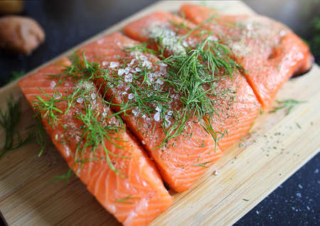 healthy and delicious salmon in the kitchen with spices