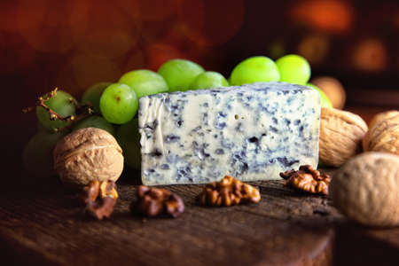 appetizing and delicious blue cheese with nuts and grapes