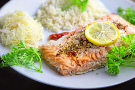 healthy baked fish salmon with rice and sauerkraut