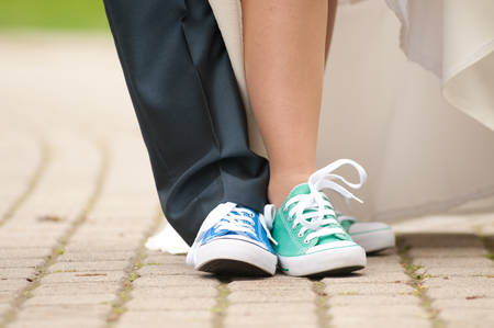 Bire and groom feet in color gym shoes photo