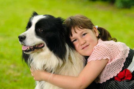 Vintage dressed little girl with border collie dog photo