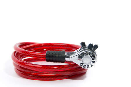 Red numeric combination bicycle lock on isolated white background photo