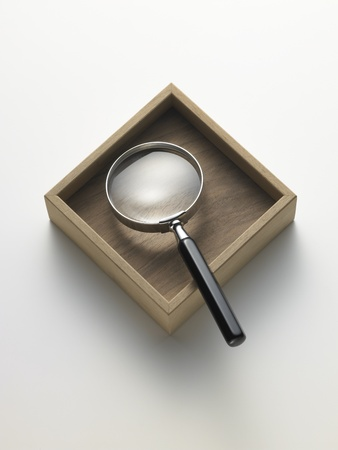 magnifying glass in the box Stock Photo
