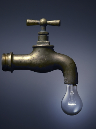energy sources: faucet with a light bulb, ecology concept for water and energy  Stock Photo