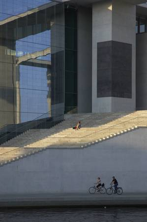 Woman sitting on outdoor steps on the phone Editorial