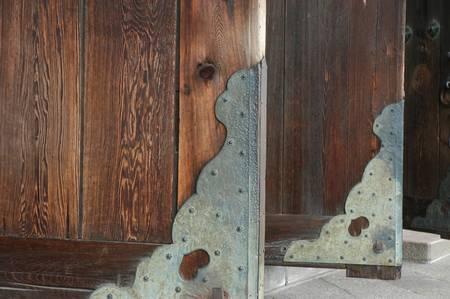 Old wooden main door with metal decoration