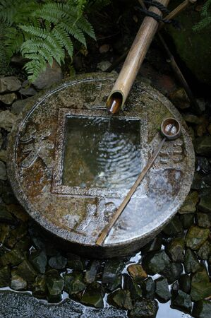 Stone basin at the entrance of a Japanese temple