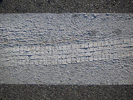 footprint wheel in the asphalt
