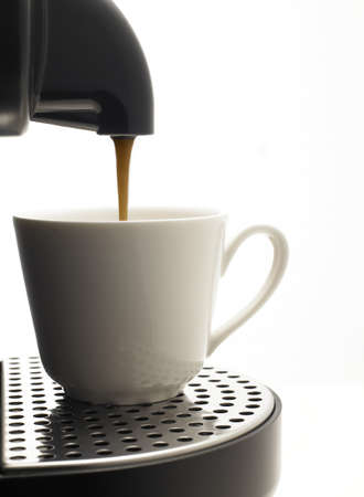 Detail on a white background a coffee machine with nice cup