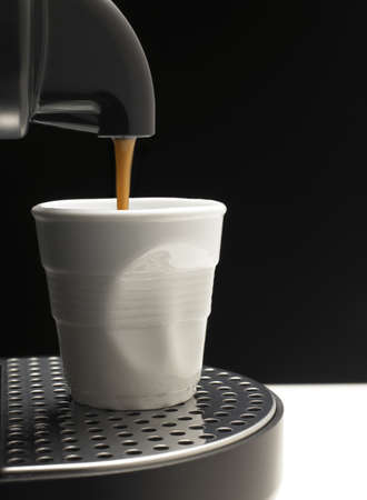 Detail on black background a coffee machine with fake cup Stock Photo