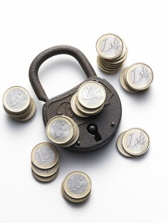 old padlock on white background with euro coins photo