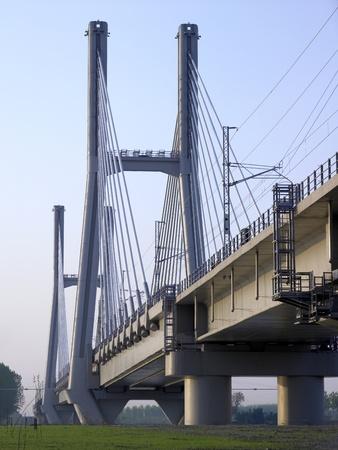 railway bridge  TAV  high speed on the river Po, Piacenza, Italy
