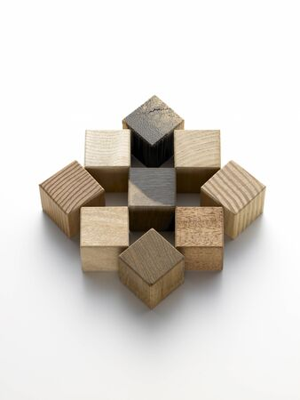 shifted: still life of various wooden cubes on a white background