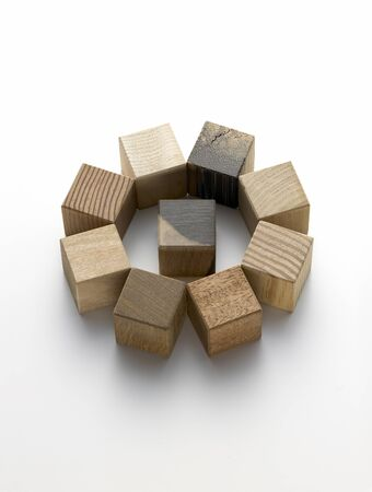 still life of various wooden cubes on a white background photo