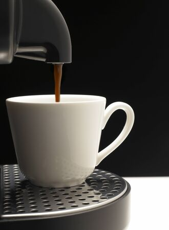 Detail on black background a coffee machine with nice cup