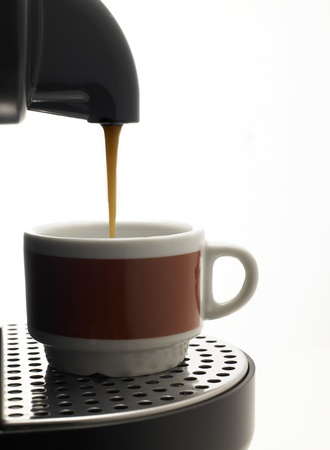 Detail on a white background a coffee machine with two colored cup