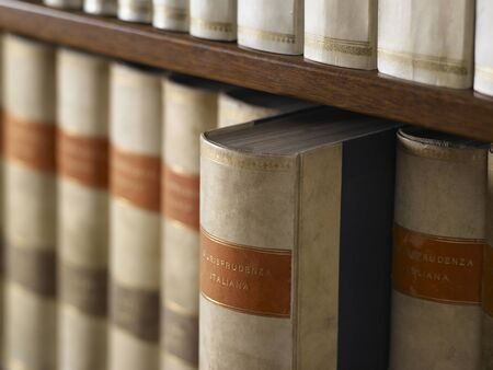 library of wood with large encyclopedic books photo