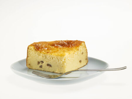 Cheese Baked Cake with apricot jam and raisins, on a white background Stock Photo