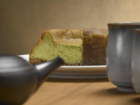 Tea Matcha cheese cake, on a wood background Stock Photo