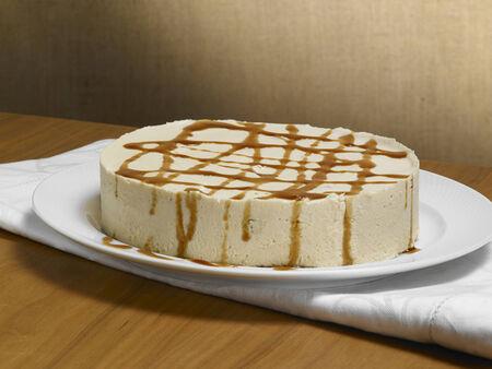 caramel chocolate cake, on a wood background