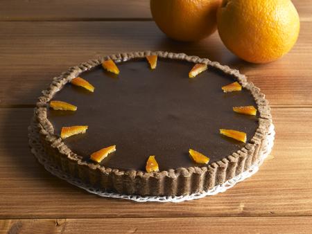 sweet food dessert, chocolate cake and orange, on a wood background Stock Photo