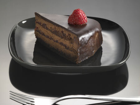 sweet food dessert, chocolate cake with strawberries, on a glossy black background