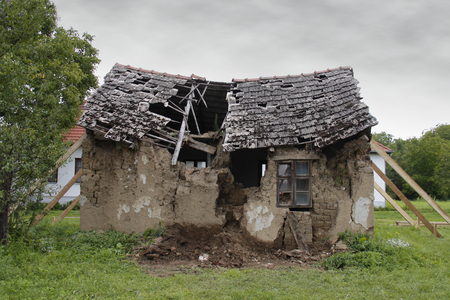 ruined house, propped and with broken roof