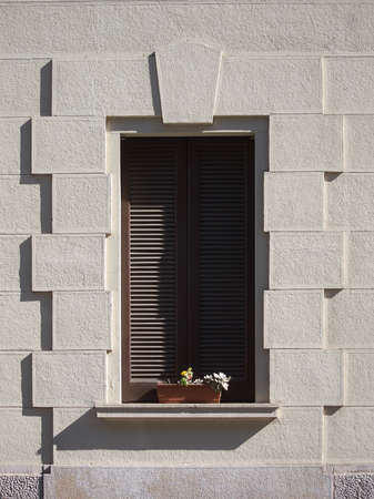 window with closed shutters in old house