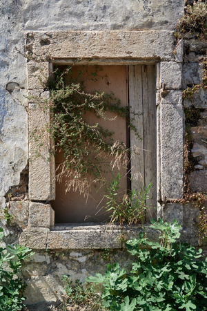 Old closed window of an old house